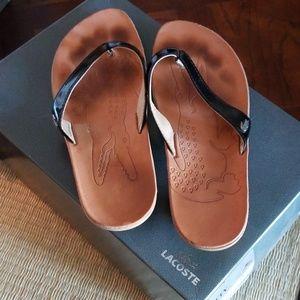Lacoste  pattern leather flip flops